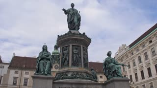 Architecture of the Austro-Hungarian Empire. Monument of the Kaiser Franz 1 in the Old City of Vienna. Dolly Shot