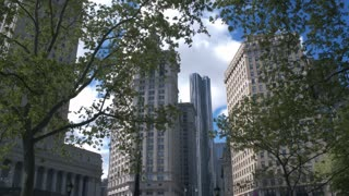 Area of administrative buildings in Manhattan. Foley Square . Dolly shot. Street intersection and green space in the Civic Center neighborhood of Lower Manhattan, New York City