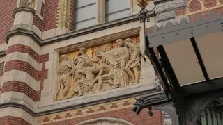 Bas-relief on the facade of the station building in Amsterdam close-up.