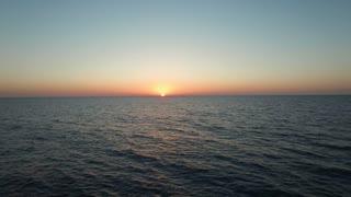 Beautiful sea landscape: lighthouse at sunset.