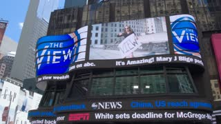 Billboards with advertising on Times Square. Dolly shot.