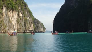 Boats in the fantastic landscape of the island of phiphi-lei. Maya bay