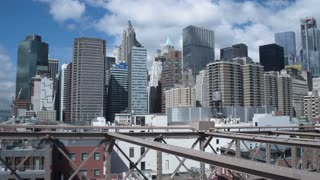 Financial district of Manhattan, view from the Brooklyn bridge. Dolly shot.