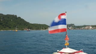 Flag of Thailand on the bow of the boat