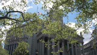 Law and order of the USA. The State Palace of Justice in the center of Manhattan in New York in Roman architecture style. Dolly shot.