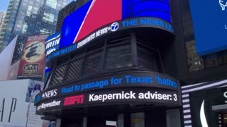 Marketing and advertising. Electronic billboards in the center of New York on Times Square. Dolly shot.
