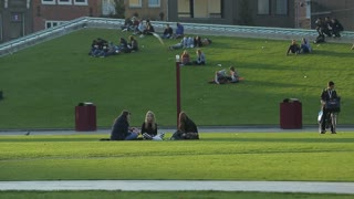 NETHERLANDS, AMTERDAM - 20 SEP 2016: Young people resting on the lawn of the roof of one of the buildings in Amsterdam.