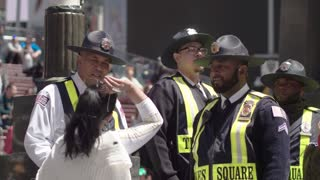 New York police in a crowd of tourists in Times Square