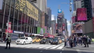 NYPD regulate the pedestrian and traffic in the center of Manhattan - Times Square. Steadicam shot.