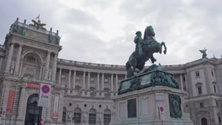 Palaces and monuments of ancient Europe. Hofburg Castle in the center of the old Vienna . The statue of Archduke Charles