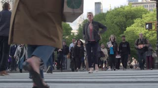 Pedestrian crossing in the middle of a working day in the center of Manhattan. Dolly shot