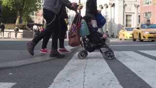 Pedestrian crossing in the middle of a working day in the center of Manhattan. Steadycam shot