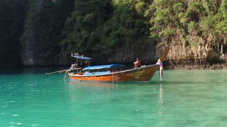 PHIPHI, THAILAND - 10 JAN 20117: Boat in the fantastic landscape of the island of phiphi-lei. Maya bay