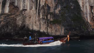 PHIPHI, THAILAND - 10 JAN 20117: Tourists on a boat sail to see a paradise island