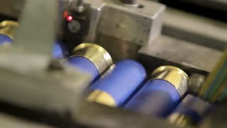 Process of production of bullets. Industrial concept. Factory equipment and macine.
