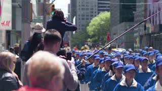 Public events in New York. Parade of Chinese workers in Manhattan. Reporters shoot for news channels. Dolly shot