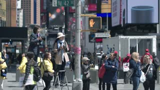 Reporters shoot news stories in the streets of Manhattan for news channels.