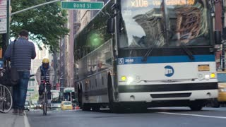 Road traffic on the streets of New York City, Manhattan . Cars, pedestrians, buses.