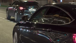 Night traffic in Moscow. The rhythm of the city. Modern foreign cars and domestic cars on the roads of evening Moscow. The movement of cars close up.