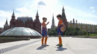 RUSSIA, MOSCOW - 24 may 2018: Moscow, Manezhnaya square. Greeting two young players.