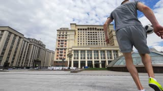 RUSSIA, MOSCOW - 24 may 2018: Professional work of a football player with a ball on Manezh square against the background of beautiful historical buildings.