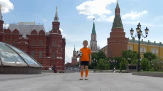 RUSSIA, MOSCOW - 24 may 2018: The future of Russian football. Young football player with the ball on the Manege square in Moscow.
