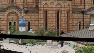 SERBIA, BELGRAD - 11 may 2017: Majestic building of St. Mark's Church in Belgrade. View from the window of a nearby building, destroyed during the bombing of NATO military.