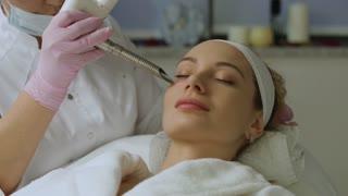 Spa. Skin treatment facial laser. Modern equipment.