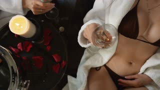 The conversation of the two girls in the modern Spa for a glass of champagne.