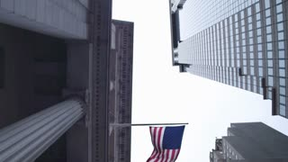 The Federal Reserve and the banking system of the United States of America. American flags on the buildings of banks in the financial quarter of New York City. Dolly shot.
