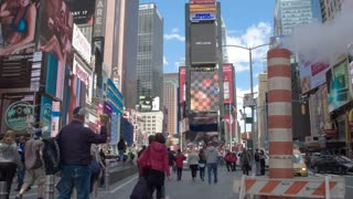 Times Square in the heart of Manhattan. The smoking pipe, tourists, traffic, billboards on the general plan. Dolly shot