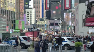 Tourist and commercial center of Manhattan- Times square. Skyscrapers with electronic billboards, advertising, tourists. Dolly shot.