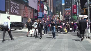 Tourists and New Yorkers walking in Times square. Steadicam shot