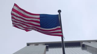 United States flag on an office building in the financial district.