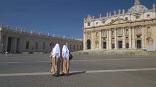 VATICAN CITY - 9 JULY 2017: Sisters in Christ on the square in front of St. Peter's Basilica in the Vatican.