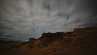 Moonlit Night Sky Timelapse over remote dune scape