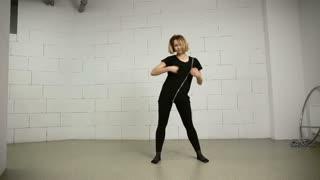 Asian woman dances in studio modern and street choreography Jazz-funk