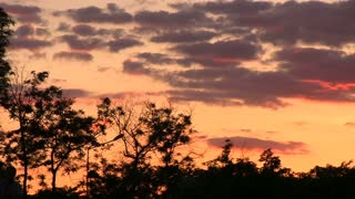 Slide sunset clouds dusk slowmotion red colors.