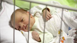 ugly newborn baby boy lying down. In the arena, in the hospital.