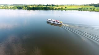 aerial view of travel ship in river with green banks