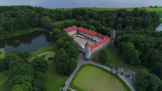 flight over old castle in green forest