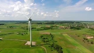 wind turbines in green fields