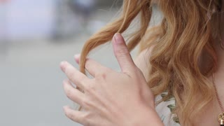 beautiful young woman closeup. his hair in the wind. slow motion