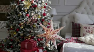 Christmas interior in the studio. large plan. Bed and Christmas tree