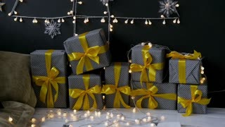 Christmas presents with a yellow ribbon in the Christmas interior