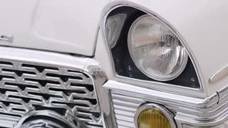 classic white retro machine. headlights close-up. slow motion