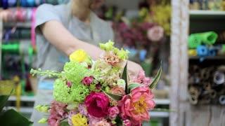 female florist making bouquet in my shop. flower business