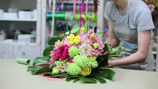 female florist making bouquet in my shop. flower business