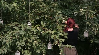 redhead young girl prepares a tree for the holiday