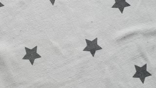 white background with stars. slow movement. natural fabrics